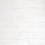 El modelo de madera superficial del primer en el blanco pintó al tablero de madera en el viejo fondo de madera de la textura de l Foto de archivo