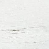 El modelo de madera superficial del primer en el blanco pintó al tablero de madera en el viejo fondo de madera de la textura de l Fotografía de archivo libre de regalías