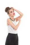 El modelo de moda de la elegancia está presentando Fotografía de archivo