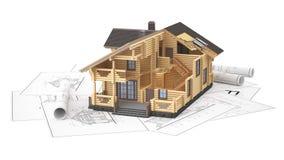El modelo de una cabaña de madera en los dibujos del fondo Foto de archivo