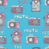 El modelo inconsútil de la foto de las cámaras mano-ahoga garabatos Foto de archivo