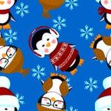 El modelo inconsútil de los pingüinos viste la Navidad Fotos de archivo
