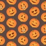 El modelo inconsútil lindo estacional de Halloween con la calabaza tallada feliz y triste hace frente en fondo negro libre illustration