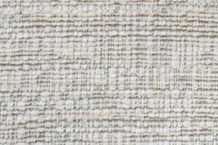El modelo superficial de la tela del primer en el sofá marrón viejo de la tela texturizó el fondo Foto de archivo libre de regalías