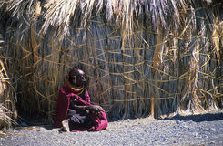 El molo woman, Lake Turkana, Kenya. El molo woman sitting in front of a hut Stock Images