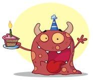 El monstruo feliz celebra cumpleaños con la torta Fotos de archivo