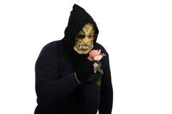 El monstruo negro que olía un rosado subió Foto de archivo