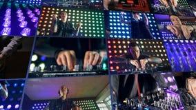 El montaje, multiscreen el fondo DJ en el club de noche que juega música usando placas giratorias almacen de metraje de vídeo