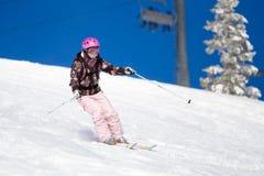 El montar en los esquís Imagen de archivo libre de regalías