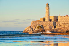El morro fortress and lighthouse in Havana at sunset. El morro fortress and lighthouse at sunset , a symbol of the city of Havana Royalty Free Stock Photos