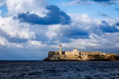 El Morro spanish fortress walls with lighthouse with sea in the Royalty Free Stock Photos