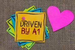 El mostrar conceptual de la escritura de la mano conducido por A1 Movimiento del texto de la foto del negocio o controlado por un fotografía de archivo