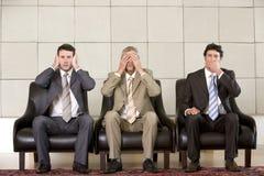 El mostrar de tres hombres de negocios   Imagen de archivo libre de regalías