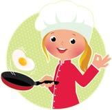 El mover de un tirón del cocinero huevos fritos o una tortilla Foto de archivo