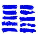 El movimiento de la brocha de la tinta azul del vector de la colecci?n fij? movimientos decorativos del cepillo del grunge exhaus ilustración del vector