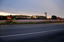 El movimiento ligero blured del coche por mañana en el camino Imágenes de archivo libres de regalías