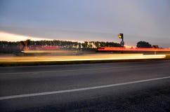El movimiento ligero blured del coche por mañana en el camino Fotografía de archivo libre de regalías