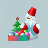 El muñeco de nieve con una caja del ` s del Año Nuevo juega Imagenes de archivo