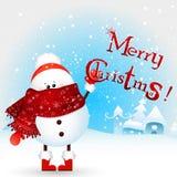 ¡el muñeco de nieve de la Navidad del bebé lleva a cabo Feliz Navidad del texto! Tarjeta de felicitación de la Navidad Ilustració Foto de archivo