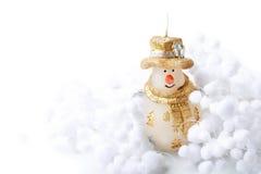 El muñeco de nieve de la vela y la bola de la nieve adornan por Feliz Año Nuevo de la Feliz Navidad en el fondo blanco con el tex Fotografía de archivo libre de regalías