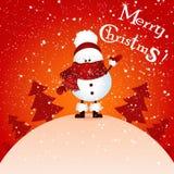 El muñeco de nieve lindo lleva a cabo Feliz Navidad de la bandera y Feliz Año Nuevo y árbol de navidad Foto de archivo libre de regalías