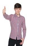 El muchacho adolescente de la moda detiene su pulgar Foto de archivo