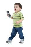 El muchacho adorable trae el teléfono a la mama sobre blanco Imágenes de archivo libres de regalías