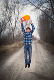 El muchacho alegre con un globo Fotos de archivo libres de regalías