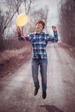 El muchacho alegre con un globo Foto de archivo