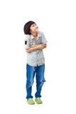 El muchacho asiático joven está mirando para arriba Imagen de archivo