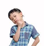 El muchacho asiático joven parece serio con el lápiz Imagen de archivo