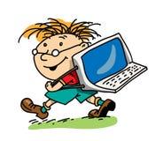 El muchacho con la computadora portátil Fotografía de archivo libre de regalías