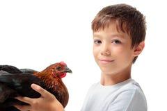 El muchacho con la gallina Imágenes de archivo libres de regalías