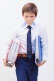 El muchacho con las carpetas Imagen de archivo libre de regalías