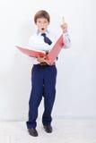 El muchacho con las carpetas Imágenes de archivo libres de regalías