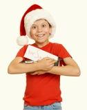 El muchacho con las galletas para santa, concepto de la Navidad de las vacaciones de invierno, amarillea entonado Fotografía de archivo libre de regalías