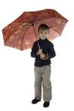 El muchacho con un paraguas Foto de archivo