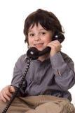 El muchacho con un telefone Fotografía de archivo libre de regalías