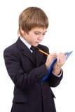 El muchacho con una tarjeta para escribe, aislado Imágenes de archivo libres de regalías