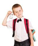 El muchacho debe ir a la escuela aislada en el fondo blanco Imágenes de archivo libres de regalías