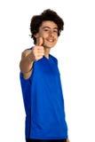 El muchacho del adolescente detiene sus pulgares Imágenes de archivo libres de regalías