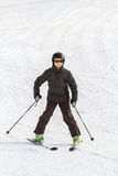 El muchacho del esquí en Suiza Fotos de archivo libres de regalías