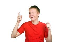 El muchacho, el adolescente con una crema para un problema y Fotografía de archivo libre de regalías
