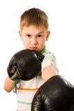 El muchacho en guantes de boxeo Fotografía de archivo