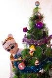 El muchacho en un banquete del Año Nuevo Foto de archivo libre de regalías