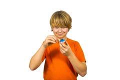 El muchacho enciende una vela Fotos de archivo libres de regalías