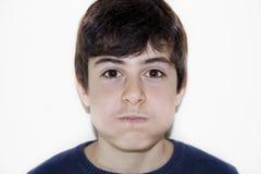El muchacho está agujereando Imagen de archivo libre de regalías