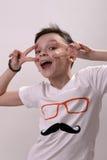 El muchacho está riendo Imagen de archivo libre de regalías