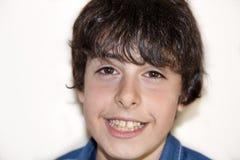El muchacho está sonriendo Foto de archivo libre de regalías