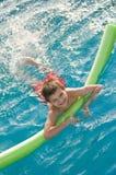 El muchacho goza en la piscina Imágenes de archivo libres de regalías